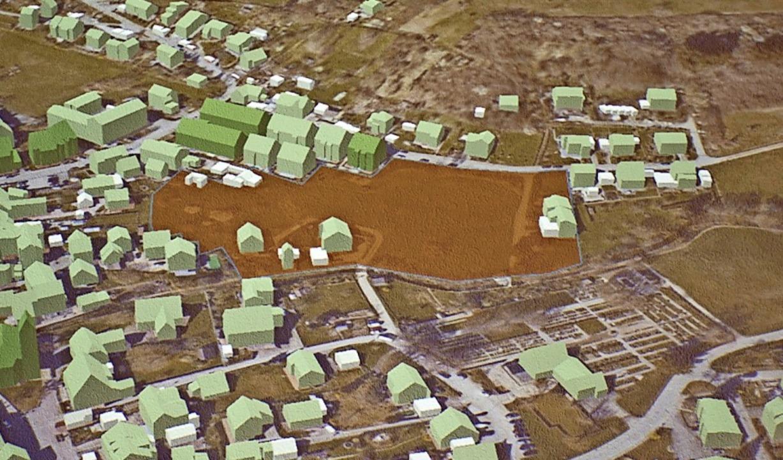 Das Modell zeigt in der Mitte das Baugebiet mit seinen 24 Bauplätzen.  | Foto: Paul Schleer