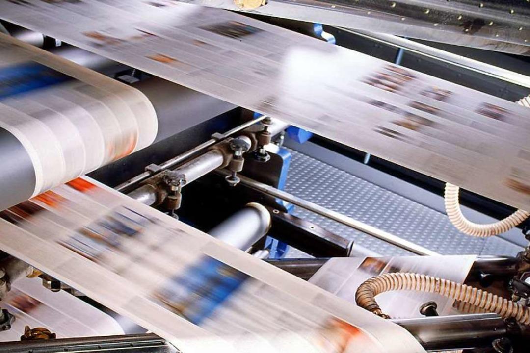 Machen Tempo: Papierbahnen in der Druckmaschine    Foto: KBA