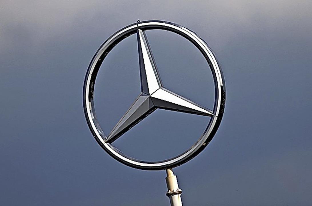 Der Daimler-Stern glänzt nicht.  | Foto: Federico Gambarini (dpa)