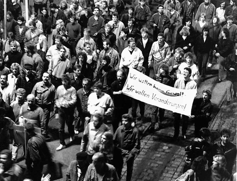 Demonstranten am 9. Oktober 1989 in Leipzig  | Foto: LEHTIKUVA (dpa)