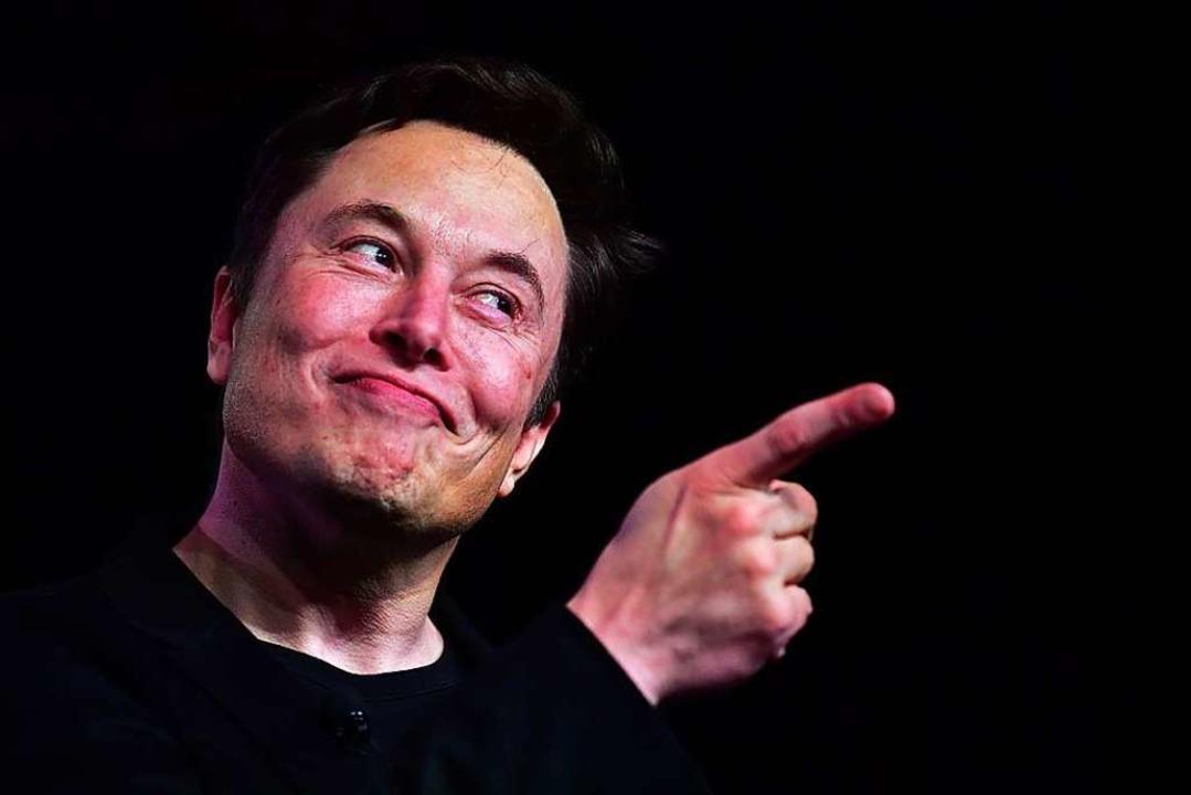 Firmenchef Elon Musk hat große Pläne &...produktion  seiner E-Autos hochziehen.  | Foto: FREDERIC J. BROWN