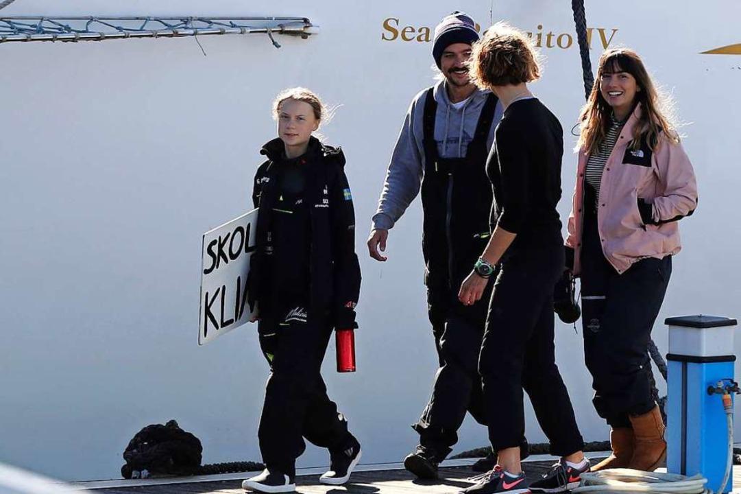 Greta Thunberg trifft auf demKatamara...in der portugiesischen Hauptstadt ein.  | Foto: Pedro Rocha (dpa)