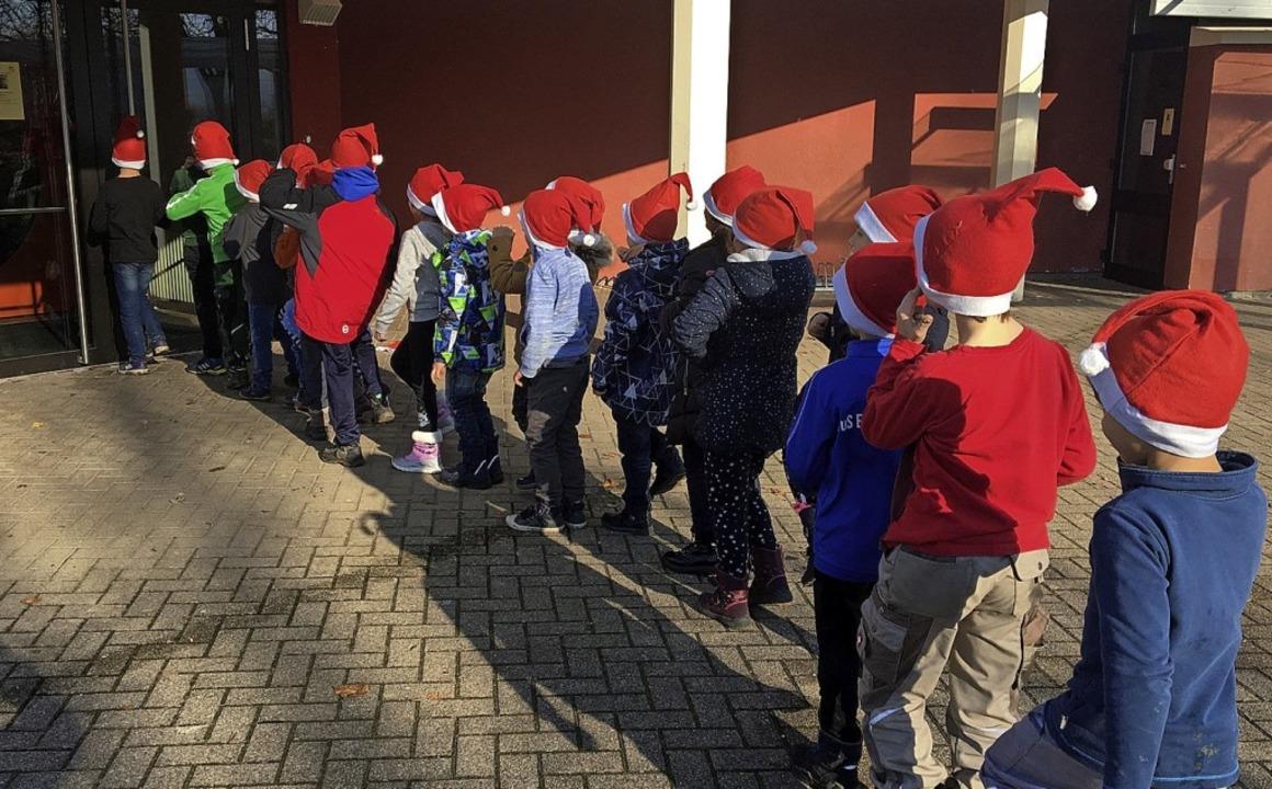 <BZ-FotoAnlauf>Grundschule Eimeldingen...beim Mittagessen in der Reblandhalle.   | Foto: Bettina Hofer-Beckmann