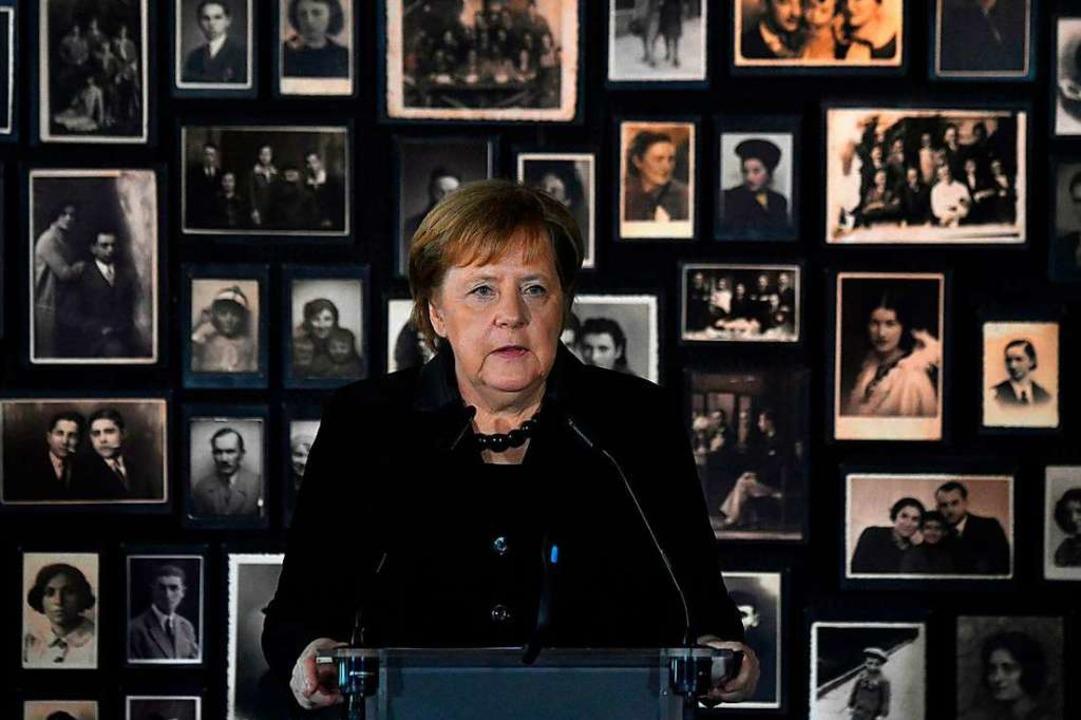 Kanzlerin Angela Merkel bei ihrer Rede in der KZ-Gedenkstätte in Auschwitz  | Foto: JOHN MACDOUGALL (AFP)