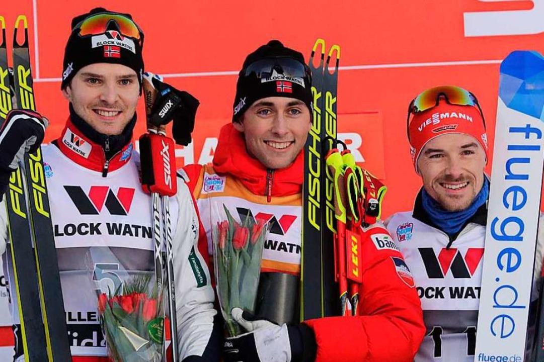 Fabian Rießle (rechts) neben  Jörgen G...(Mitte) auf dem Podest in Lillehammer.  | Foto: STIAN LYSBERG SOLUM (AFP)