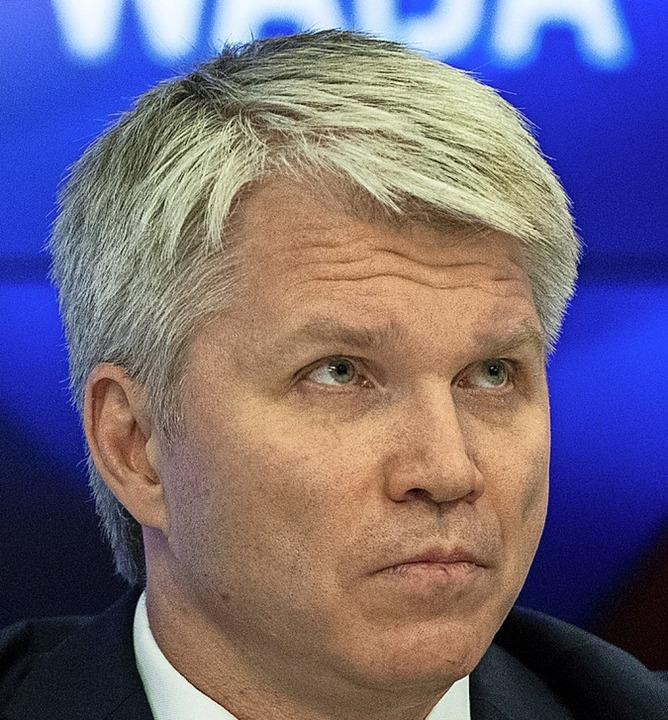 Sportminister Pawel Kolobkow will, das...tionalfahne an den Start gehen können.  | Foto: Pavel Golovkin (dpa)