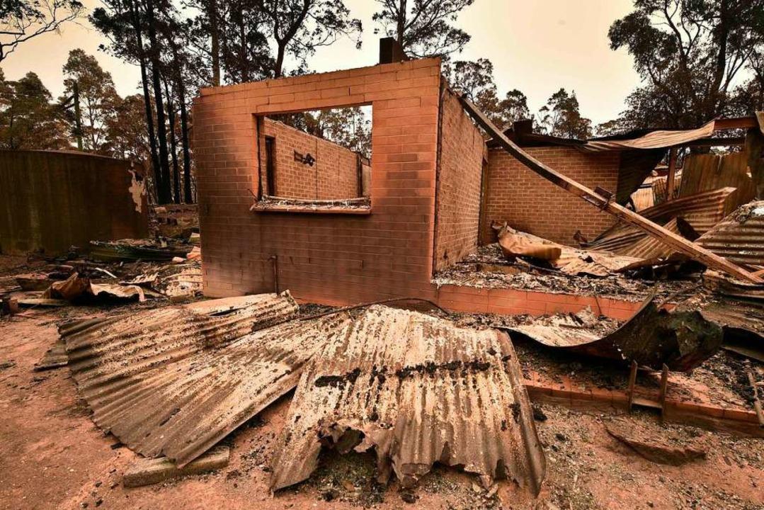 Landesweit wurden mehr als 1400 Häuser zerstört.  | Foto: PETER PARKS (AFP)