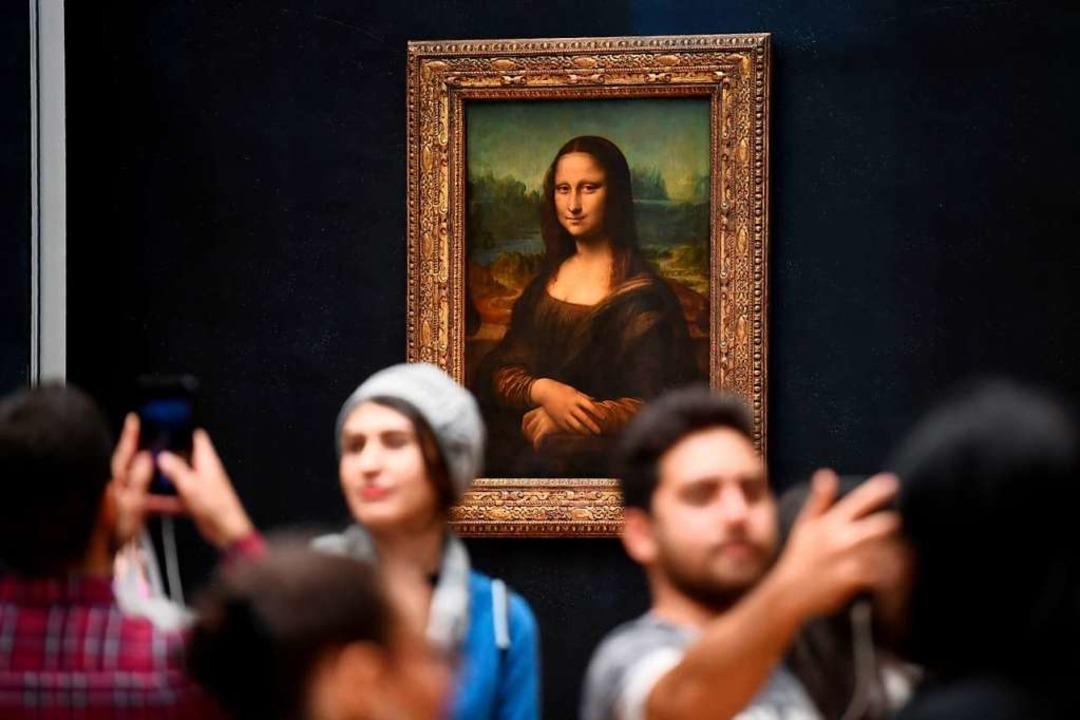 Die Mona Lisa im Louvre in Paris.  | Foto: ERIC FEFERBERG (AFP)