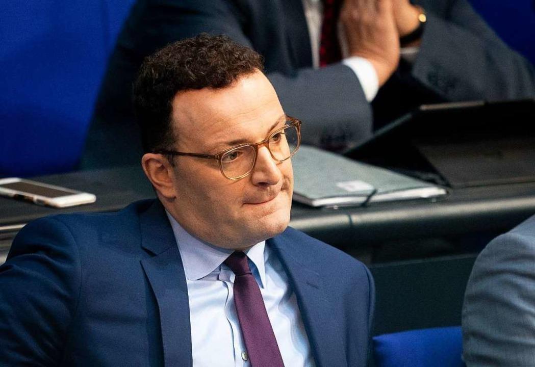Für Gesundheitsminister Jens Spahn war...eit der Abgeordneten votierte dagegen.  | Foto: Kay Nietfeld (dpa)
