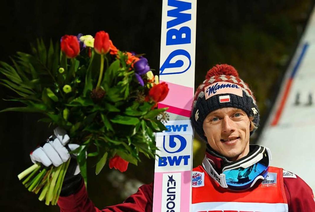 Dawid Kubacki nach seinem Sieg    Foto: Patrick Seeger (dpa)