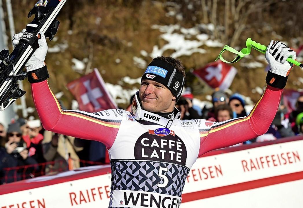 Thomas Dreßen bejubelt seinen dritten Platz.  | Foto: Marco Tacca (dpa)