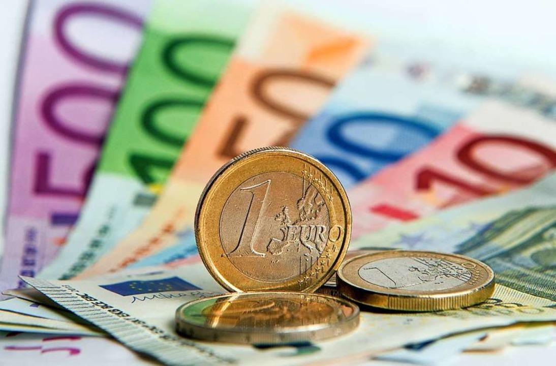 Die mittleren Einkommen in Deutschland... und FDP. FOTO: Daniel Reinhardt (dpa)  | Foto: Daniel Reinhardt (dpa)