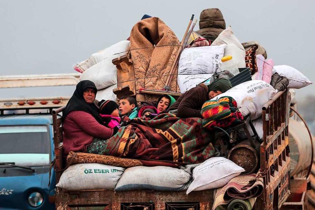 Viele Menschen sind auf der Flucht.  | Foto: Ugur Can (dpa)