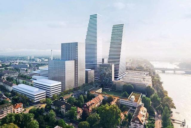 Roche baut in Basel Häuser auf und Stellen ab