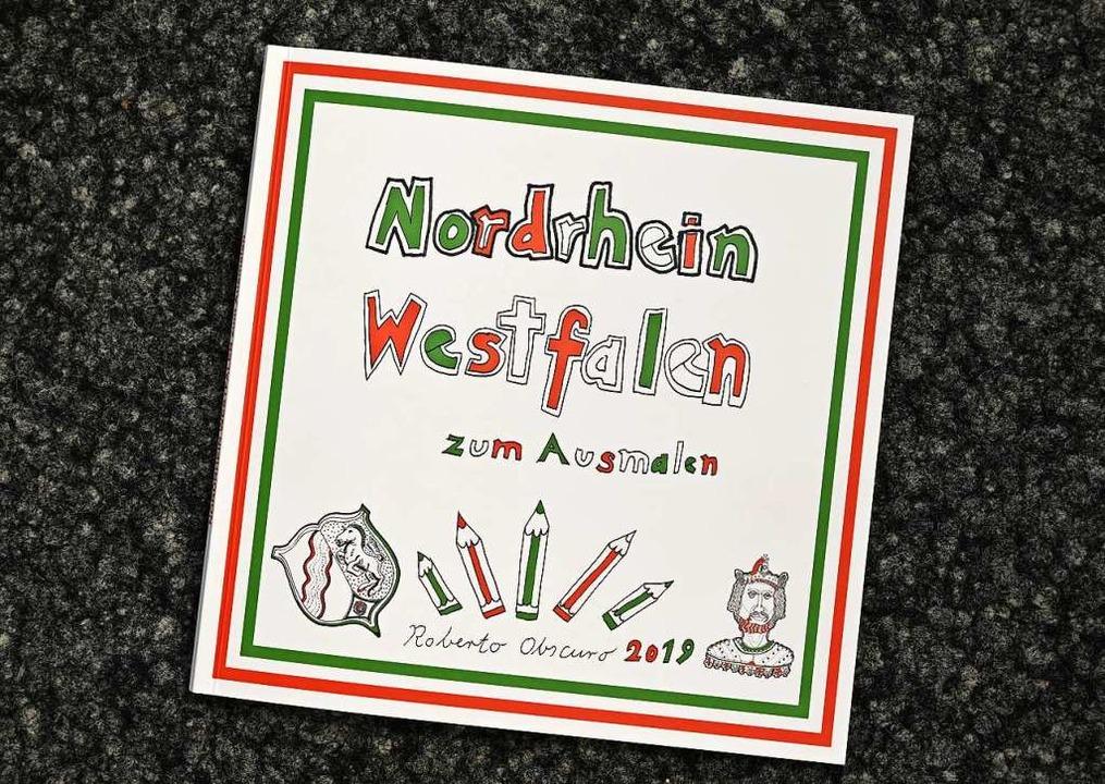 Bei einer Veranstaltung der AfD-Landta...liche Malbücher  verteilt worden sein.  | Foto: Andreas Bischof (dpa)