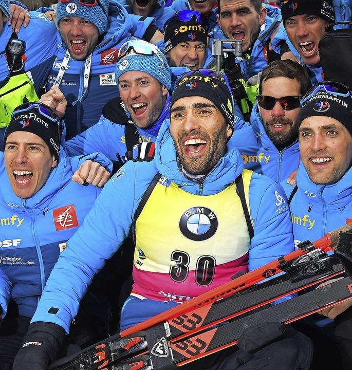 Allez les bleus:   Weltmeister  Martin...nmitten seines französischen Teams      | Foto: TIZIANA FABI (AFP)