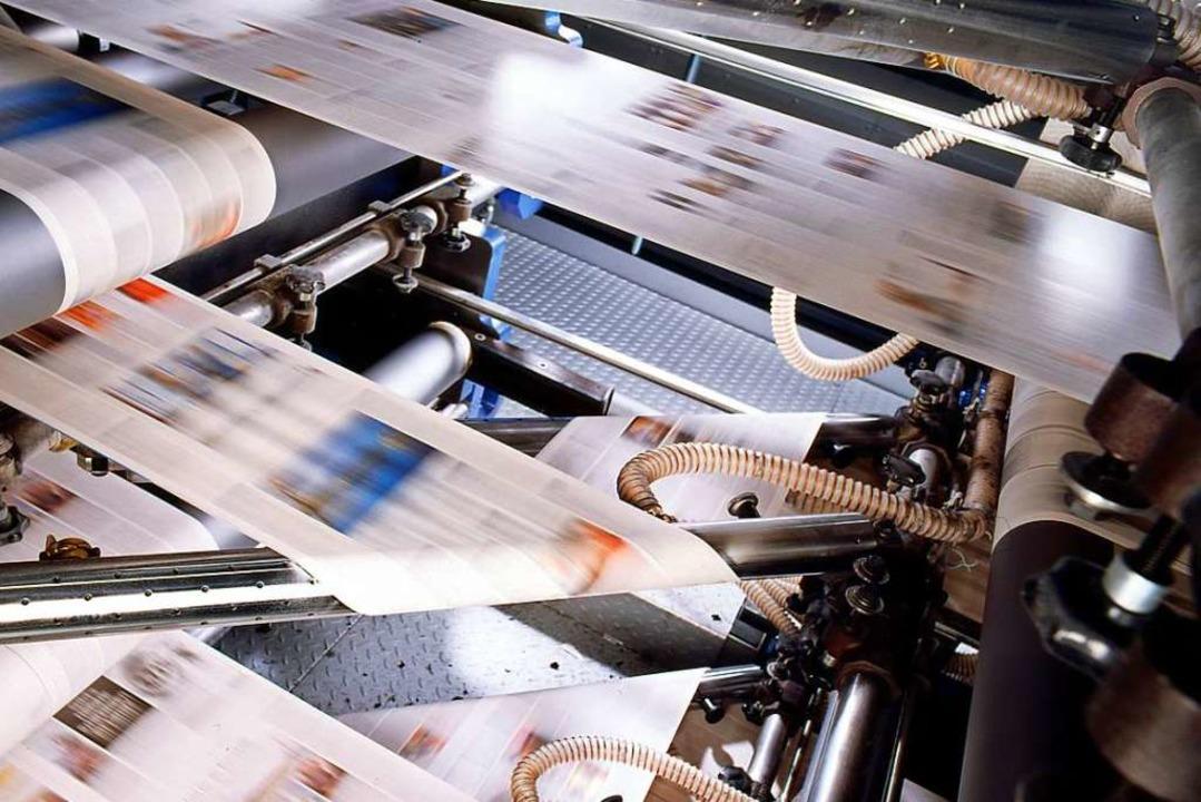 Frisch bedruckte Papierbahnen für die BZ machen Tempo.  | Foto: KBA