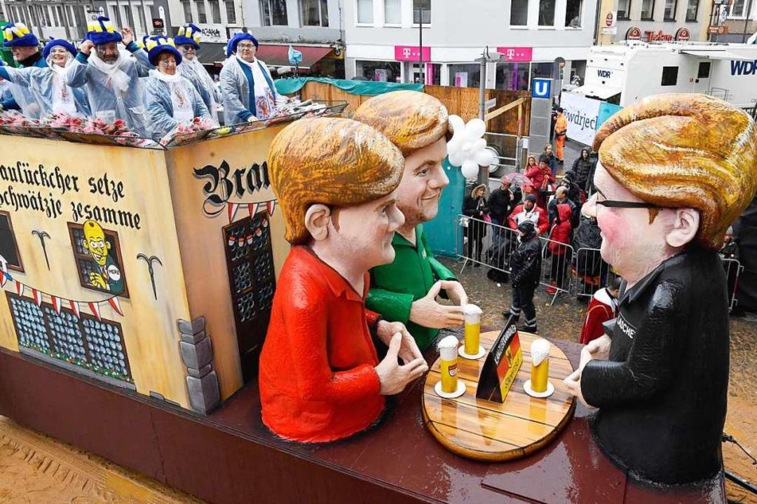 Karneval am Rosenmontag ist in Köln et...Figuren, die oft Politiker darstellen.  | Foto: Roberto Pfeil (dpa)