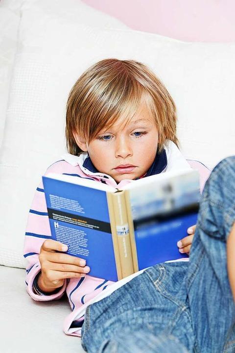 Die Kinder werden nun viel Zeit zu Hau...ücher können helfen, sie rumzubringen.  | Foto: Omid Mahdawi  (stock.adobe.com)