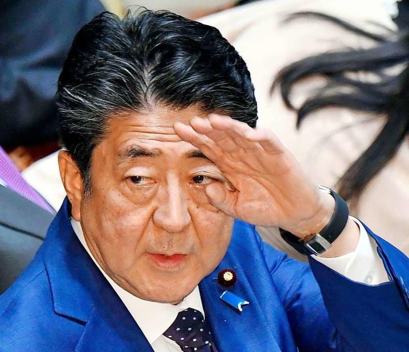japans Premierminister Shinzo Abe zieh...mpischen Spiele in Tokio in Betracht.   | Foto: Yoshitaka Sugawara (dpa)