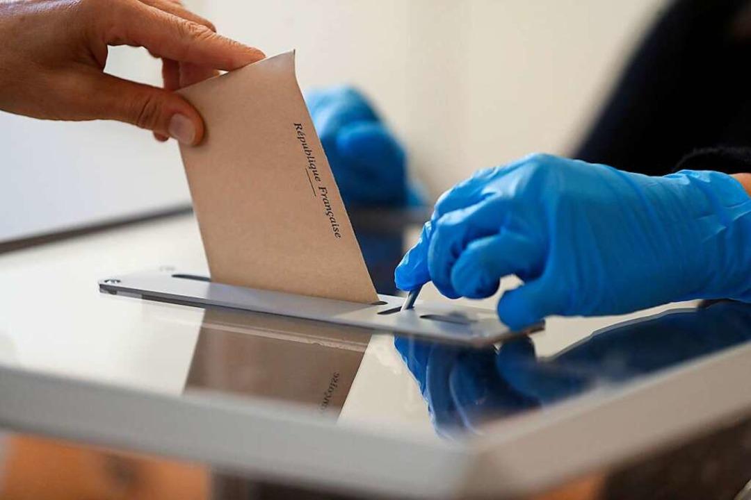 Wahlen in Zeiten von Corona – da... spricht sich für das Verschieben aus.  | Foto: Jean-Francois Badias (dpa)