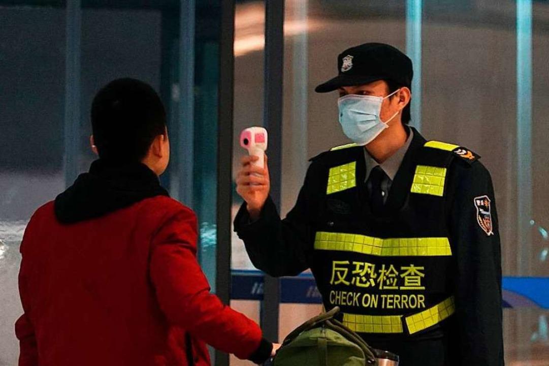 Corona-Kontrolle in Wuhan: Kann man den Daten aus China trauen?  | Foto: Dake Kang (dpa)