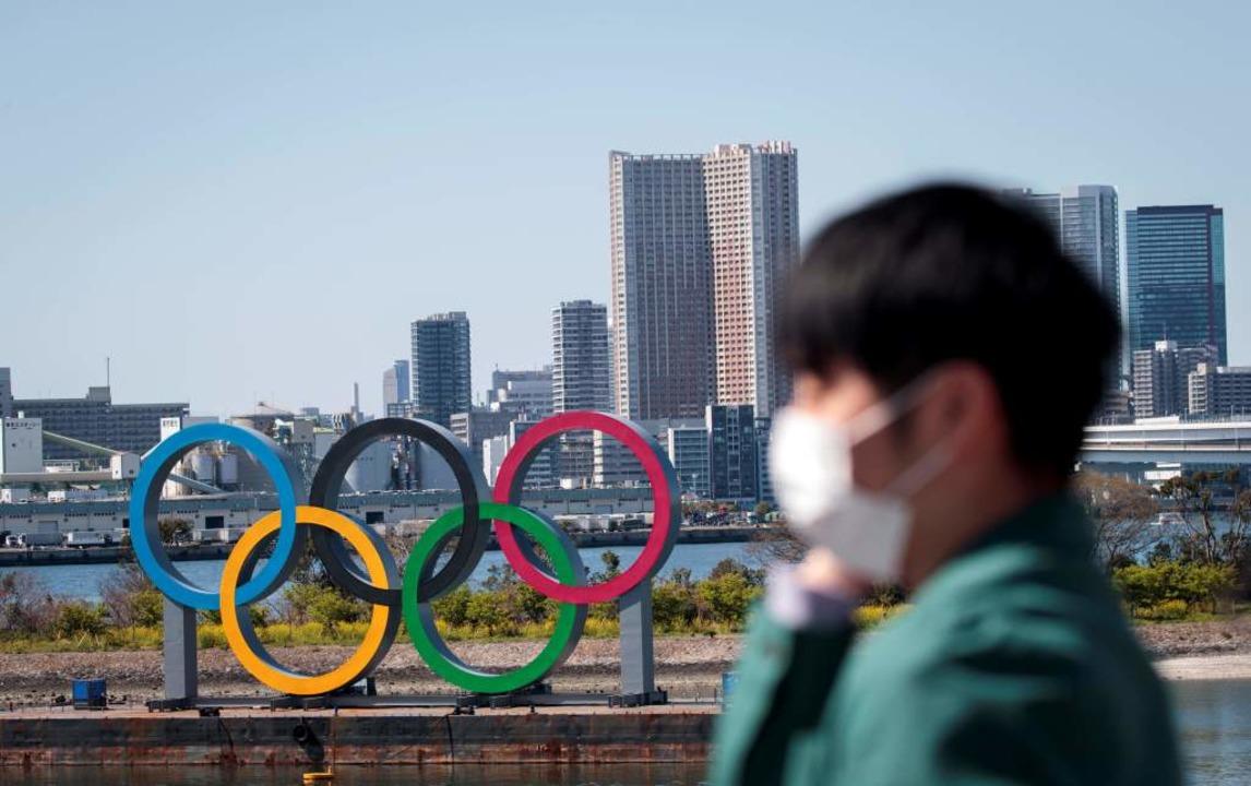 Olympia 2020 in Tokio halfen auch kein... Ringe sollen 2021 ausgetragen werden.  | Foto: BEHROUZ MEHRI (AFP)