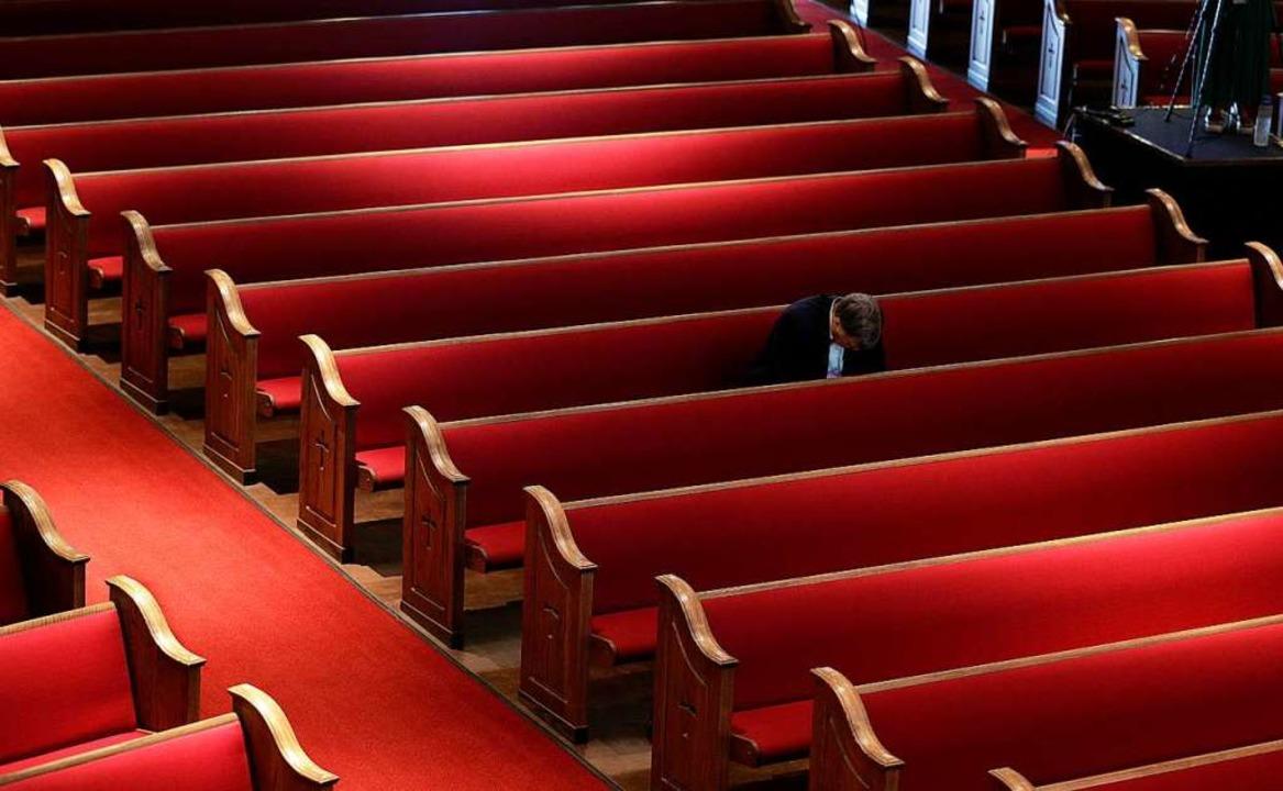 Überall an Ostern waren die Kirchen le...m Fernsehen oder Internet übertragen.   | Foto: Eric Gay (dpa)