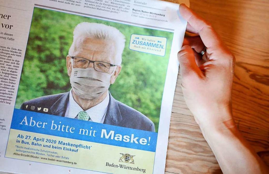 """Aber bitte mit Maske!"", a...nt Winfried Kretschmann am Wochenende.    Foto: Christoph Schmidt (dpa)"