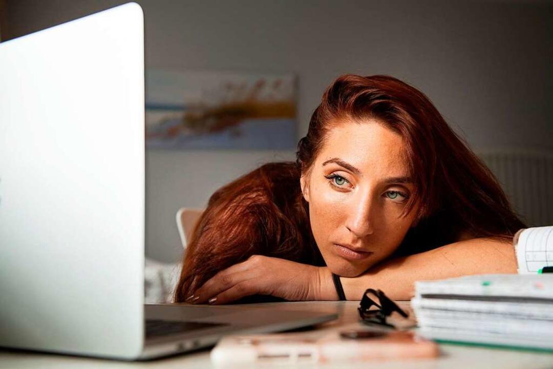 Bei der Online-Vorlesung mal wieder ab...n, motiviert bei der Sache zu bleiben.    Foto: Franziska Gabbert (dpa)