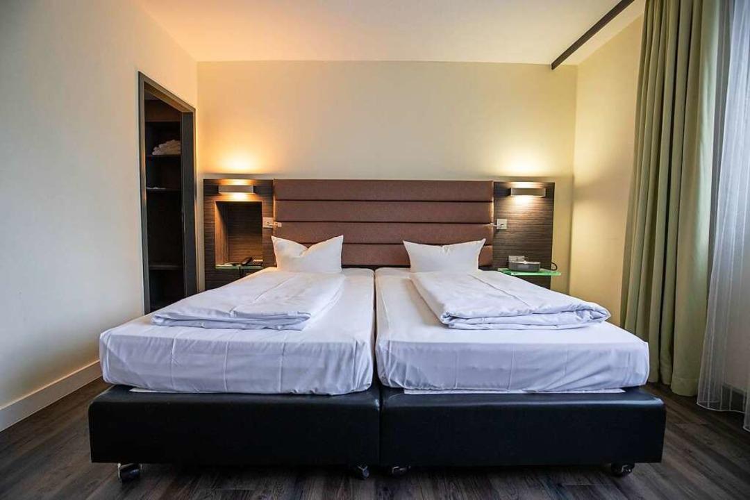 Ein leeres Hotelzimmer    Foto: Daniel Karmann (dpa)