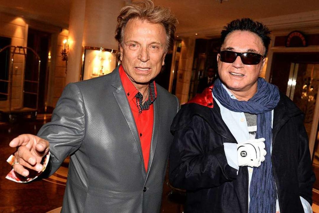 Siegfried Fischbacher und Roy Horn bei einem Besuch in München 2013    Foto: Felix Hörhager (dpa)