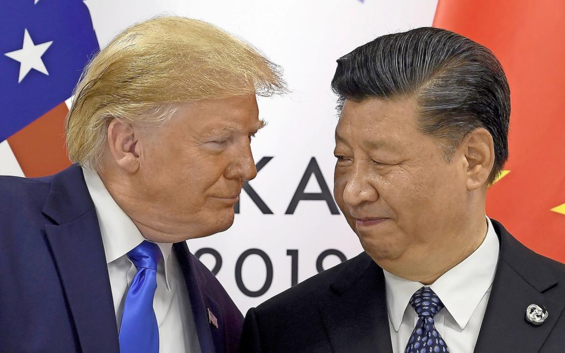 Lange galt die Beziehung zwischen den ...pfels mit Chinas Präsident Xi Jinping.  | Foto: Susan Walsh (dpa)