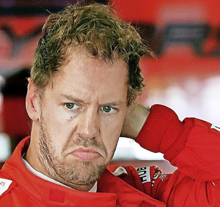 Sebastian Vettel    Foto: Tom Boland (dpa)