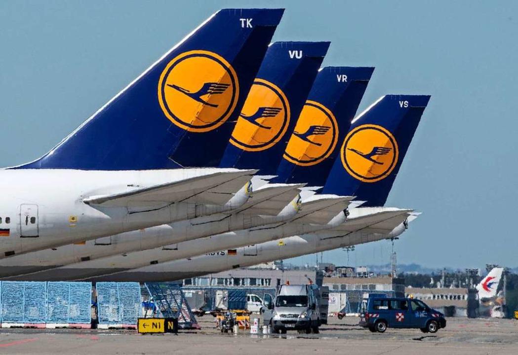 Lufthansa-Flugzeuge am Boden  | Foto: Boris Roessler (dpa)