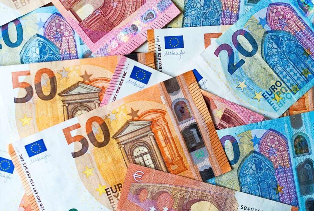 Die Stadt Freiburg kann jeden Euro bra... in diesem Jahr auf 77 Millionen Euro.  | Foto: Monika Skolimowska (dpa)