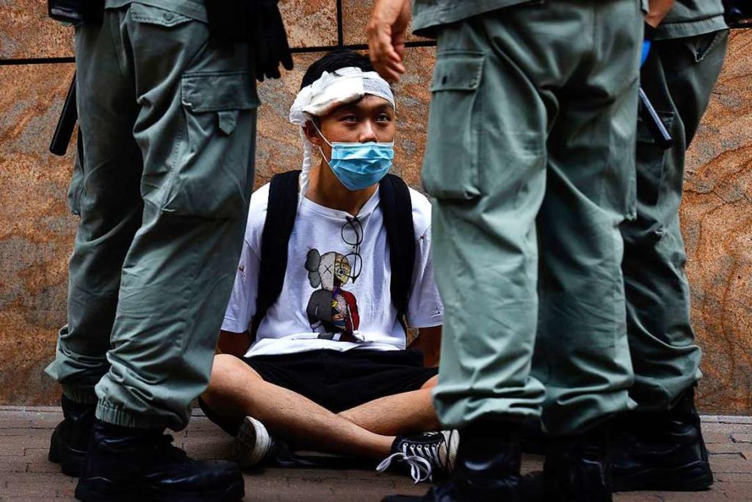 Zur Durchsetzung des Gesetzes sollen &...sorgane in Hongkong eingesetzt werden.  | Foto: Kin Cheung (dpa)