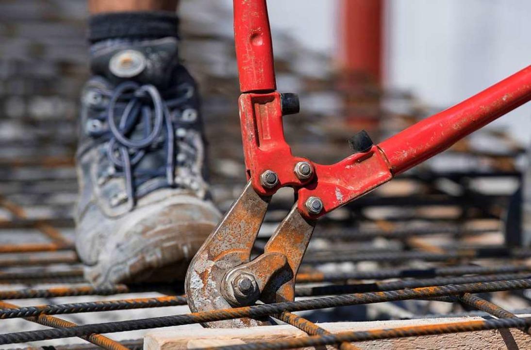 Am Bau geht die Arbeit nicht aus.    Foto: Boris Roessler (dpa)