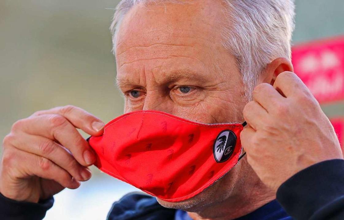 Ab dem kommenden Spieltag gibt es keine Maskenpflicht mehr am Spielfeldrand.  | Foto: Jan Woitas (dpa)