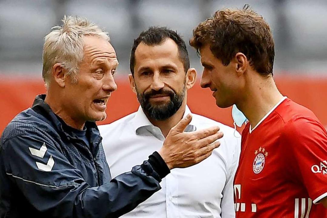 Ob sie nach dem Match in München die V...amidzic und Ex-Nationalspieler Müller.  | Foto: SVEN HOPPE (AFP)