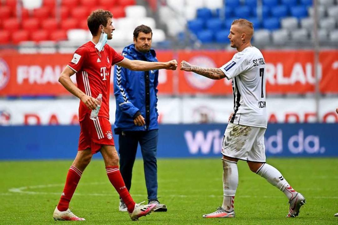Bundesliga in Corona-Zeiten: Thomas Mü...l München-Freiburg vergangenen Samstag  | Foto: Sven Hoppe (dpa)
