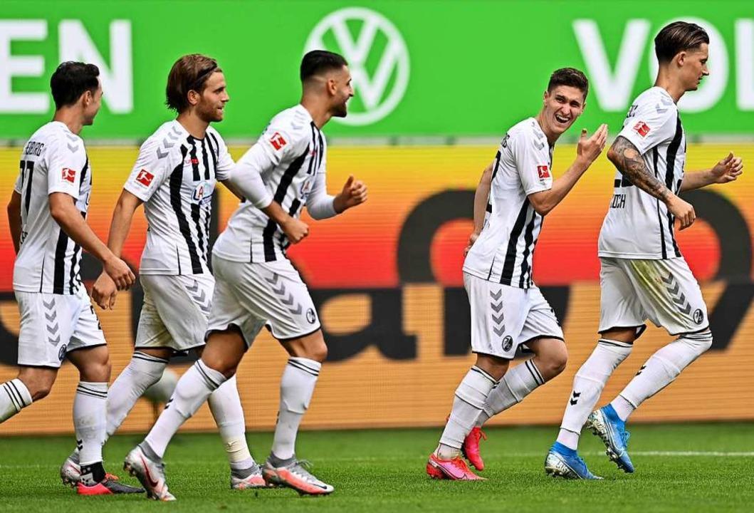 Leistungsträger beim SC, von links: Ni...o Grifo, Roland Sallai und Robin Koch.  | Foto: Sascha Steinbach (dpa)
