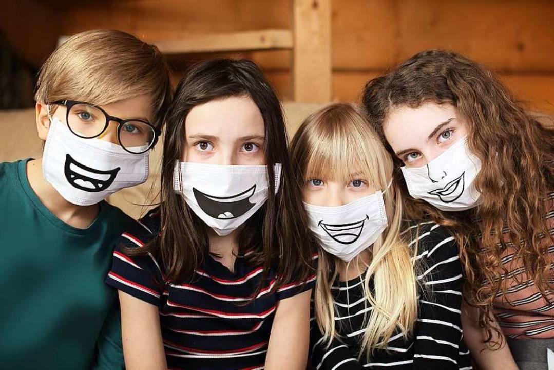 Nicht für Schülerinnen und Schüler im ...he ist eine Maskenpflicht im Gespräch.    Foto: ambrozinio - stock.adobe.com