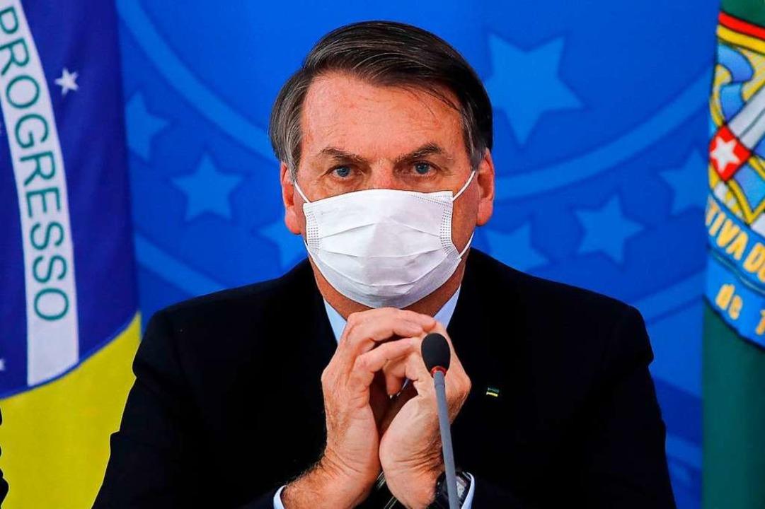 Bolsonaro bei einer Pressekonferenz im März.    Foto: SERGIO LIMA (AFP)