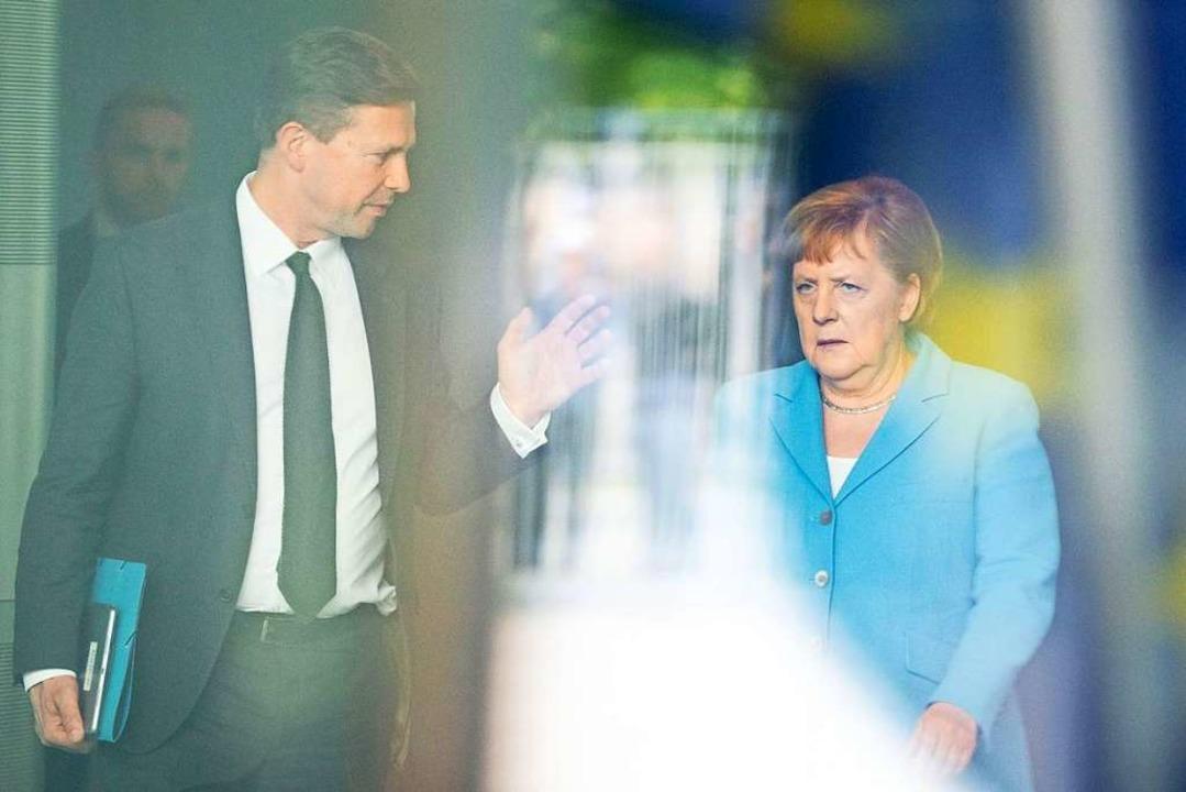 Bundeskanzlerin Angela Merkel  und  Re...ffäre bisher nicht offiziell geäußert.  | Foto: Kay Nietfeld (dpa)