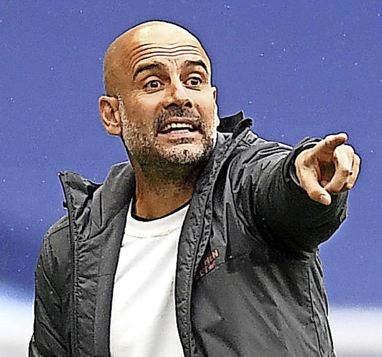 Coach Pep Guardiola versucht, Optimismus zu verbreiten.   | Foto: Michael Regan, Nmc Pool (dpa)