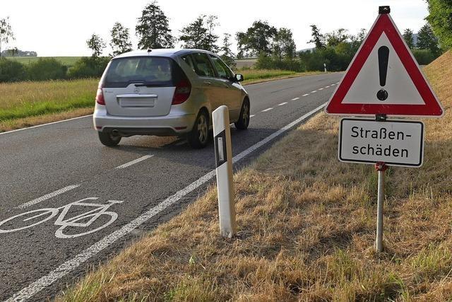 Woher kommen die Straßenschäden entlang der Radteststrecke?