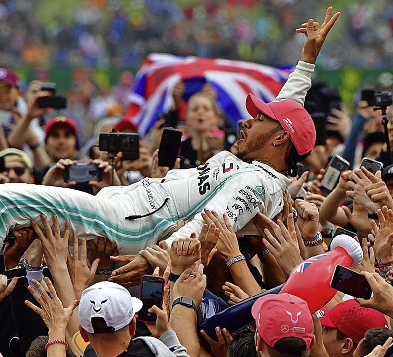 Die  Party muss ausfallen – selb...eder der Brite Lewis Hamilton gewinnt.  | Foto: ANDREJ ISAKOVIC (AFP)