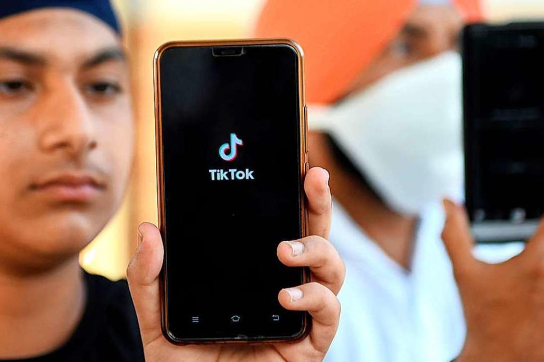 US-Präsident Donald Trump will die int...tform TikTok in seinem Land verbieten.  | Foto: NARINDER NANU (AFP)