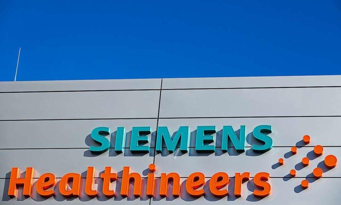 Siemens will das auf die Krebsversorgu...illiarden Dollar (14 Mrd Euro) kaufen.  | Foto: Daniel Karmann (dpa)